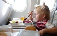 Order a kids meal before you get on the plane