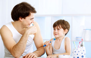 Brushing your teeth with your child can make them feel more comfortable